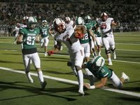 Rockwall Heath player Jay Fair (1) scores a touchdown in front of Southlake's Mason Grawe (27) and Benecio Porras (32) during their high school football game in Southlake, Texas, on Oct. 2, 2020. (Michael Ainsworth/Special Contributor)