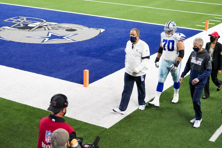 Dallas Cowboys offensive guard Zack Martin (70) head to the locker room during the second quarter against the Arizona Cardinals at AT&T Stadium on Monday, Oct. 19, 2020, in Arlington.