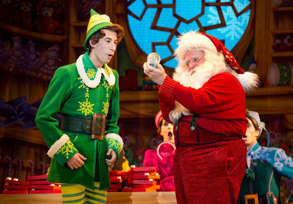 Matt  Kopec  (Buddy)  and  Gordon  Gray  (Santa)  in Elf, presented by Dallas Summer Musicals and Broadway Across America Nov. 27-Dec. 2 at Fair Park Music Hall in Fair Park.