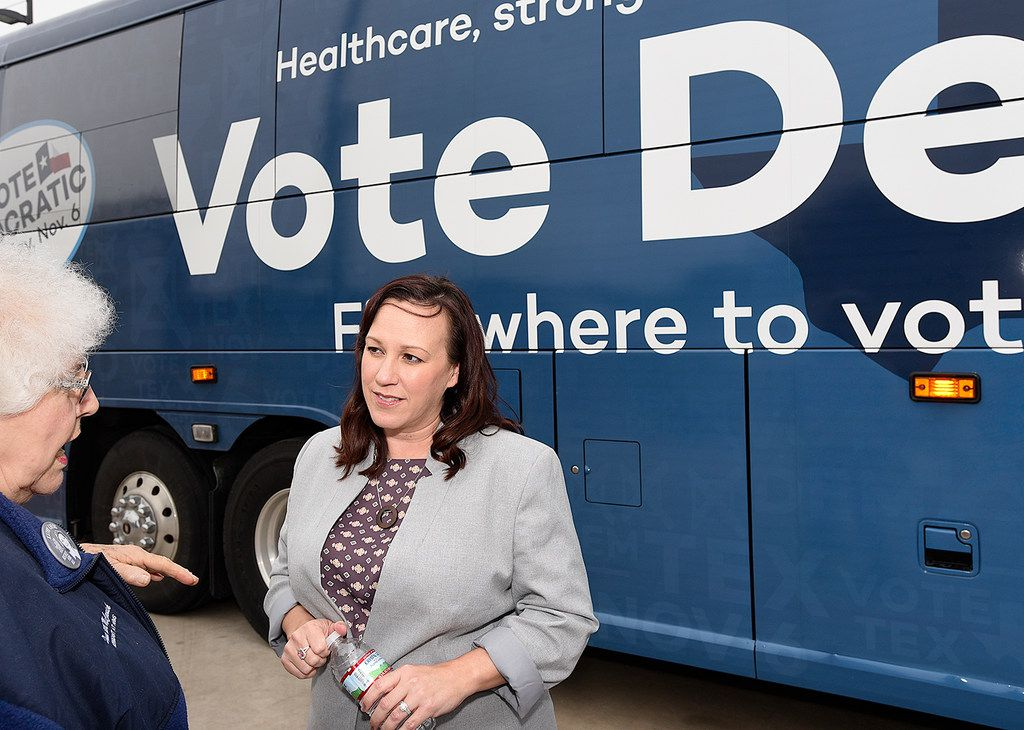 MJ Hegar,  when she was the Democratic candidate for Texas Congressional District 31, listens to a constituent at the start of the Texas Democratic Party's Fair Shot Bus Tour on Wednesday Oct. 17, 2018.