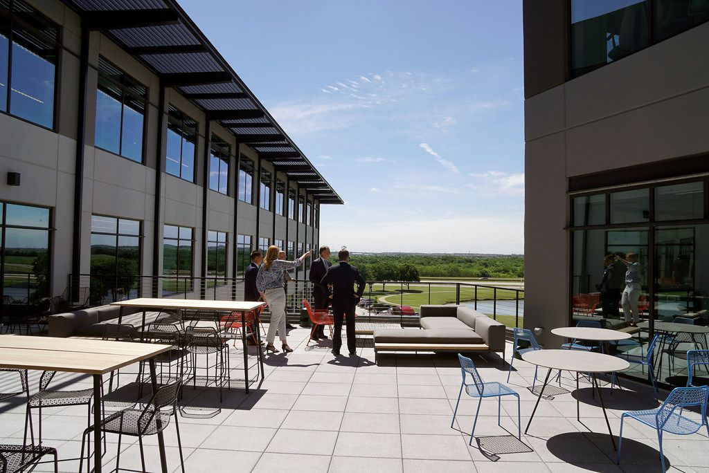 Guests spend a moment on the terrace during the grand opening of the new Mercedes Benz Business Center in Fort Worth, Texas on Thursday, May 30, 2019. Mercedes-Benz Financial Services USA LLC held a grand opening ceremony to celebrate its newly completed business center at AllianceTexas, Hillwood's 26,000-acre master-planned, mixed-use development. Some of the features of the building include facial recognition entry, smart conference rooms, and both permanent art collections and rotating art exhibitions. (Lawrence Jenkins/Special Contributor)