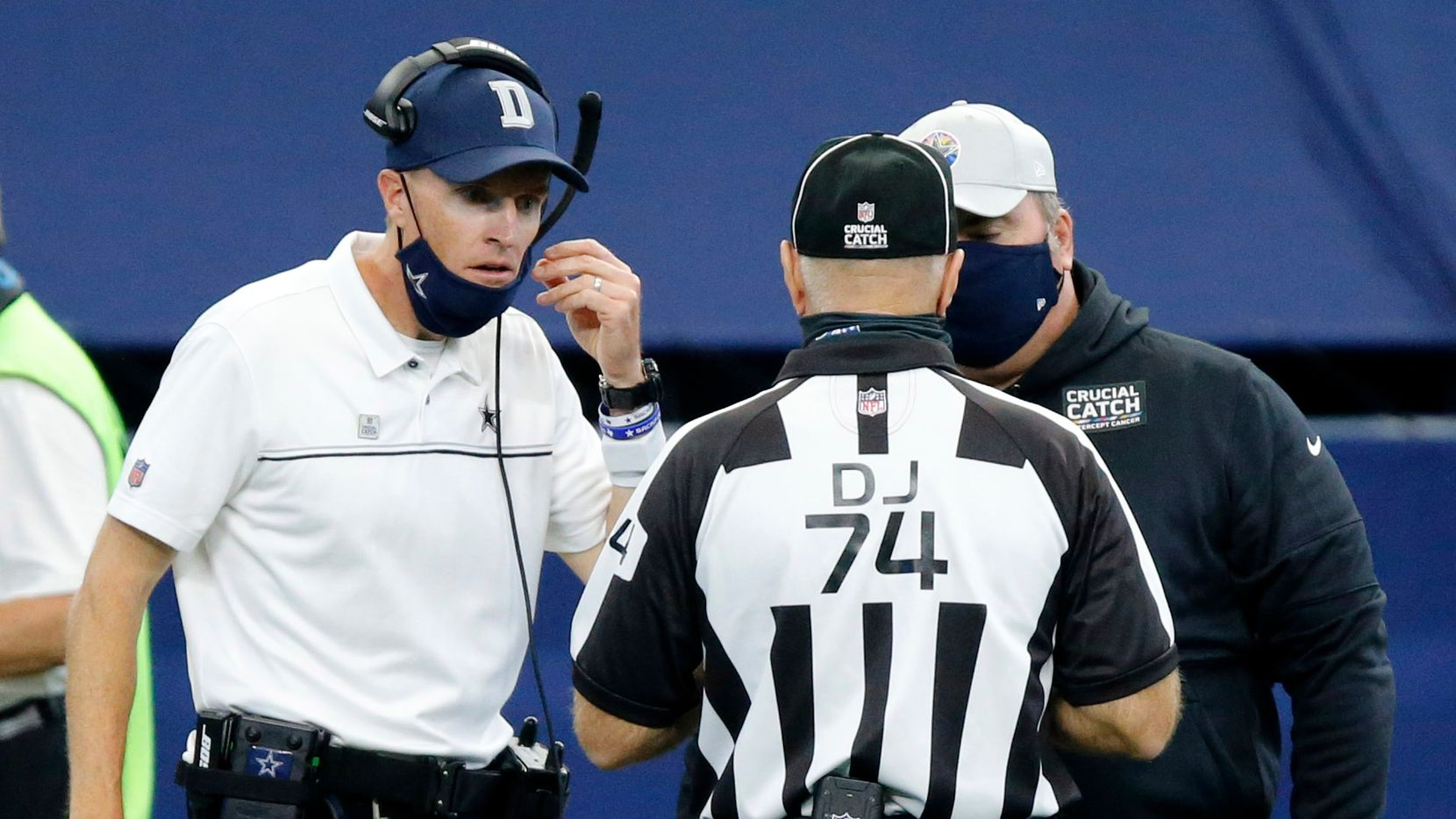 Dallas Cowboys special teams coordinator John Fassel (left) and head coach Mike McCarthy argue with official Derick Bowers (74) after a blocked extra point during the fourth quarter at AT&T Stadium in Arlington, Texas, Sunday, October 4, 2020.
