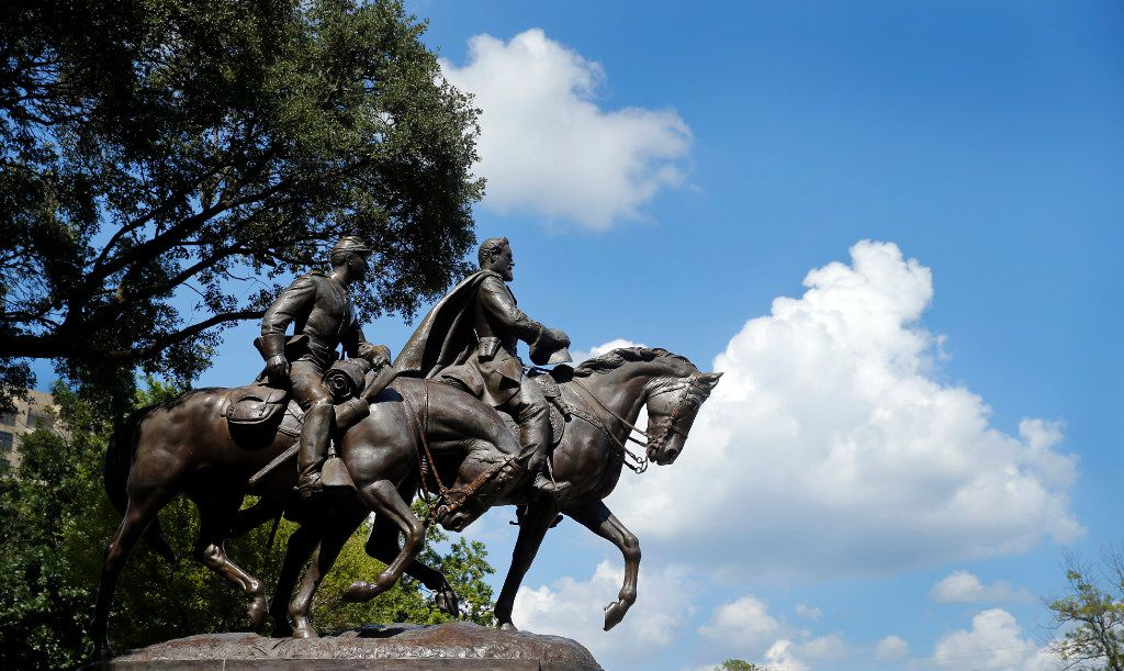 The Robert E. Lee statue in Robert E Lee Park is pictured in the Turtle Creek area of Dallas, Tuesday, July 18, 2017.  Dallas is looking at the history of its Confederate monuments and considering whether they should be removed, relocated or contextualized in some way. (Tom Fox/The Dallas Morning News)