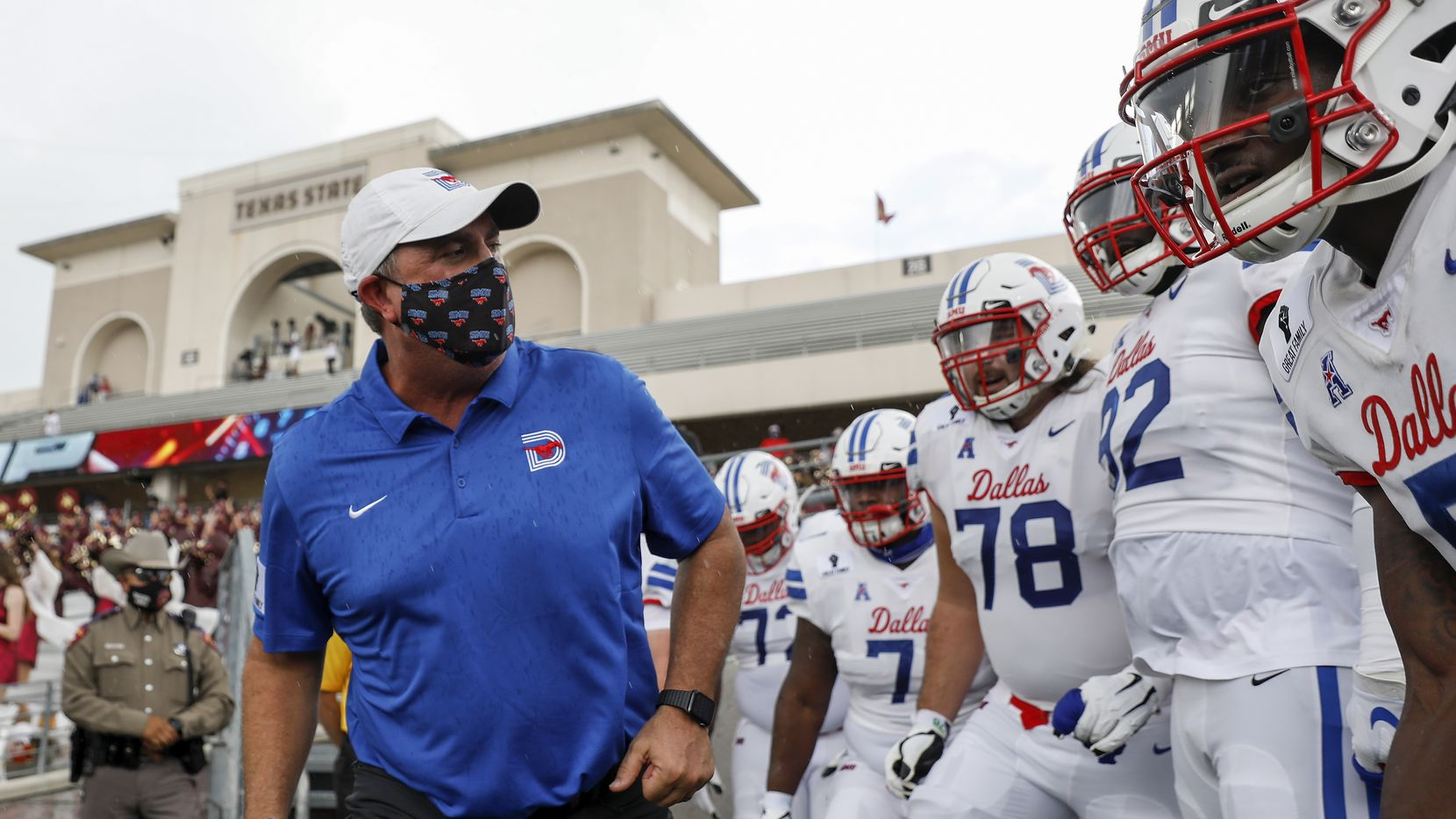 SAN MARCOS, TEXAS - SEPTEMBER 05: Head coach Sonny Dykes of the Southern Methodist Mustangs leads the team on to the field before the game against the Texas State Bobcats at Bobcat Stadium on September 05, 2020 in San Marcos, Texas. (Photo by Tim Warner/Getty Images)
