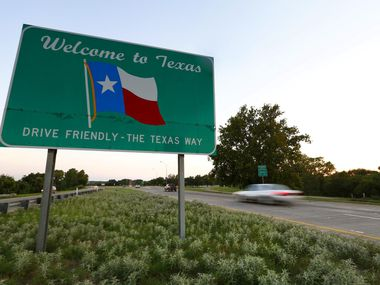 "A ""Welcome to Texas"" sign greets drivers as they enter the Lone Star State on U.S. 75 near Denison."