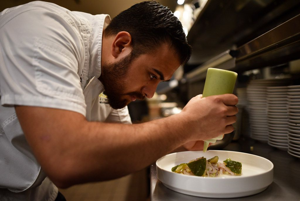 Executive chef José Meza prepares a dish of Black Habanero Ash Ceviche with Hoja Santa Tostadas from Jalisco Norte.