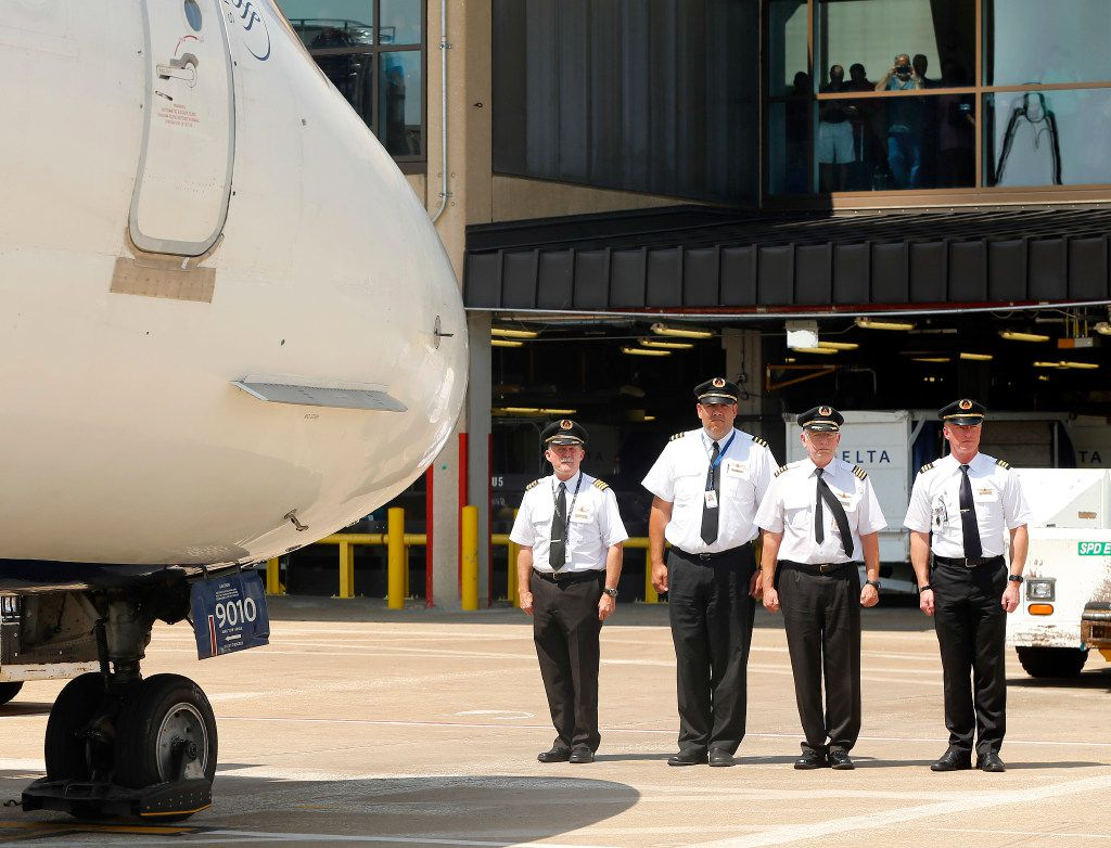 A Delta Airlines pilot crew honors the remains of Navy Seaman 1st  Class (E3) George A. Coke Jr. of Arlington which were returned from Pearl Harbor via a commercial flight at Dallas-Fort Worth International Airport, Friday, June 23, 2017. Coke, who perished in the USS Oklahoma after it sank, was identified through recent DNA testing. The North Texas Patriot Guard Riders joined the procession to Moore Funeral Home in Arlington. A service will be held at First United Methodist Church in central Arlington Saturday before being buried at Parkdale Cemetery.