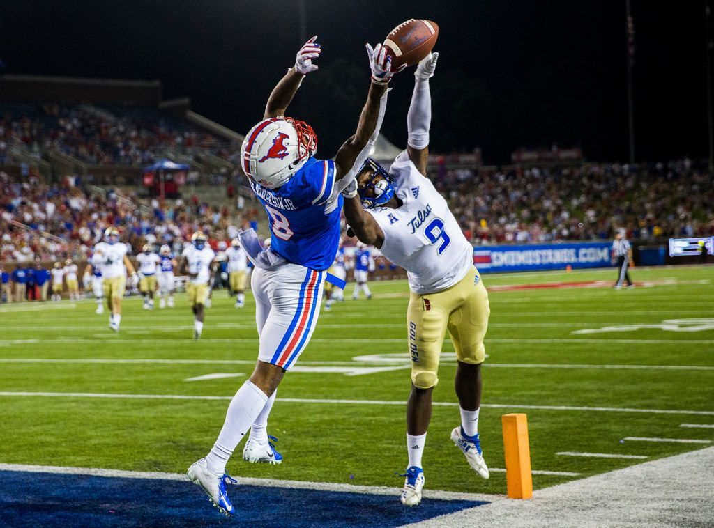 FILE - SMU wide receiver Reggie Roberson Jr. (8) can't make a catch as Tulsa cornerback Reggie Robinson II (9) defends him in the end zone during the second quarter of a game on Saturday, Oct. 5, 2019, at Ford Stadium on the SMU campus in Dallas.