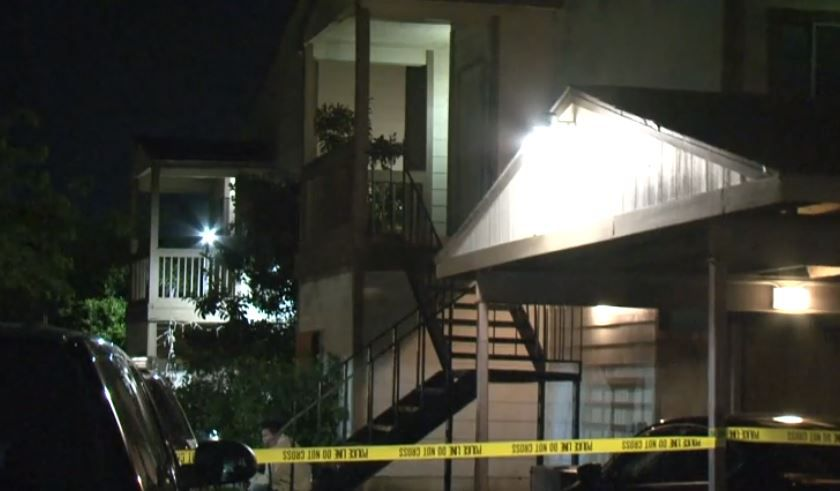 Crime scene tape blocks off an apartment where a body was discovered hidden in a bed Thursday night in Houston.