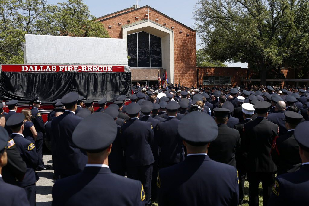 "Hundreds of firefighters and first responders waited outside St. Mary's Catholic Church of the Assumption for the casket of Dallas Fire-Rescue Captain Kenneth ""Luckey"" Harris Jr., who was killed in the explosion in West."