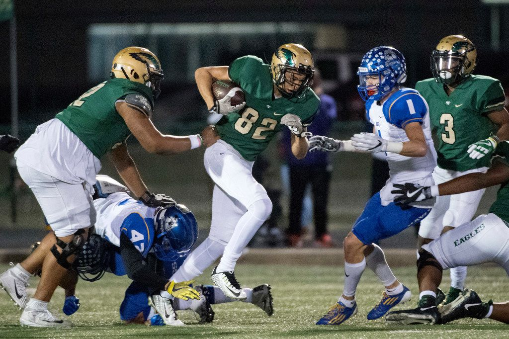DeSoto wide receiver Lawrence Arnold (82) fights for yardage against Copperas Cove during a game in 2017. (Jeffrey McWhorter/Special Contributor)