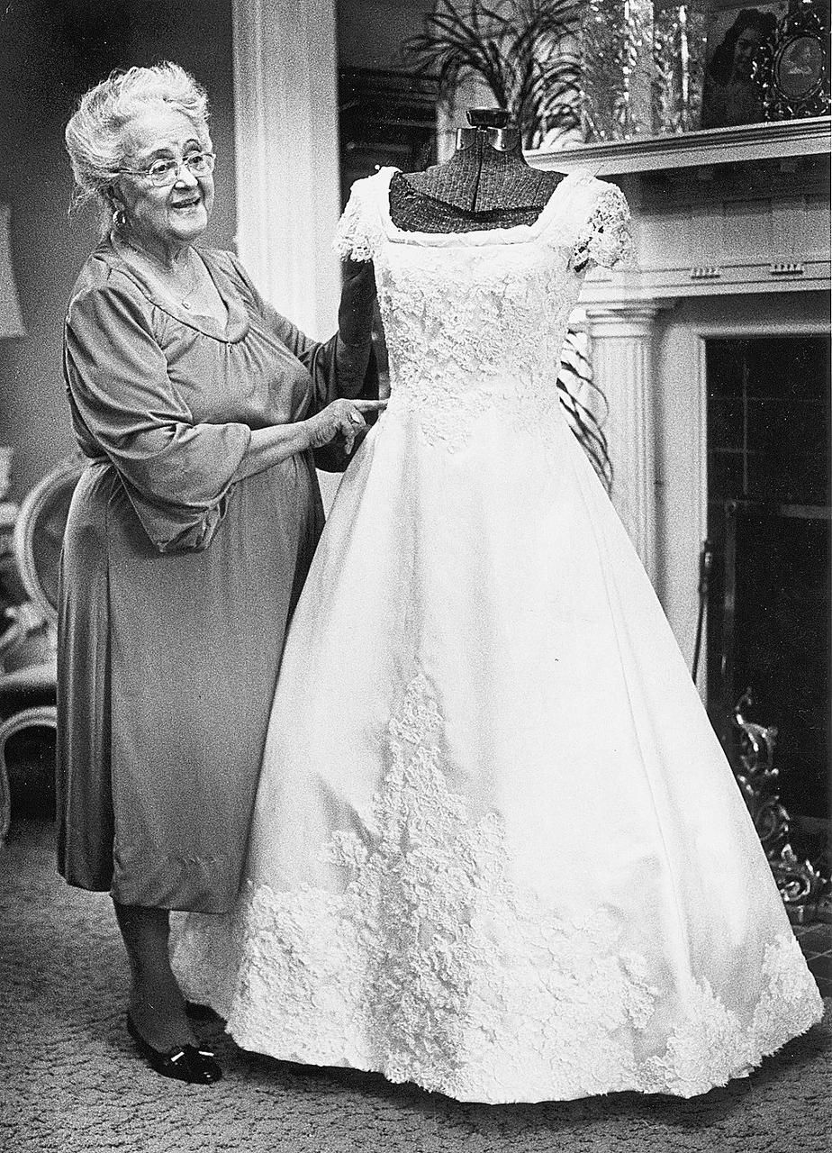Kay, shown  in a 1981 photo, used a dress form in crafting specialty dresses at her home in Raleigh.