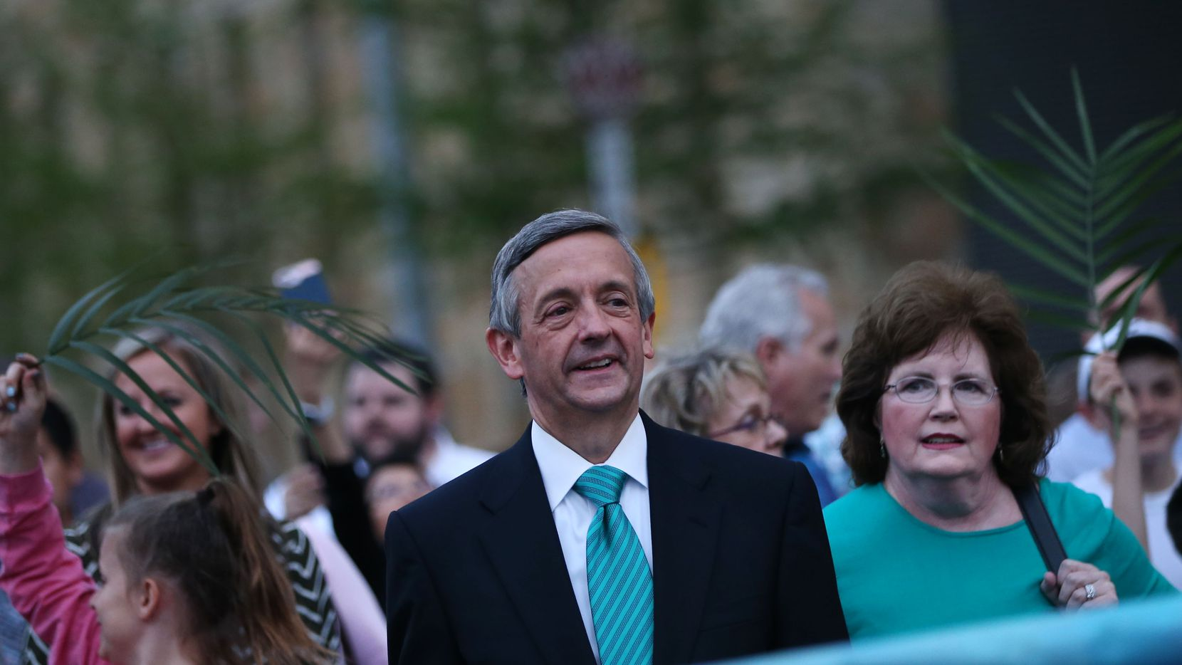 Pastor Robert Jeffress walks with his wife, Amy Jeffress, during the March for Eternal Life led by members of First Baptist Dallas in downtown Dallas on Palm Sunday, March 25, 2018. The march comes a day after the March for Our Lives protests for stricter gun control.