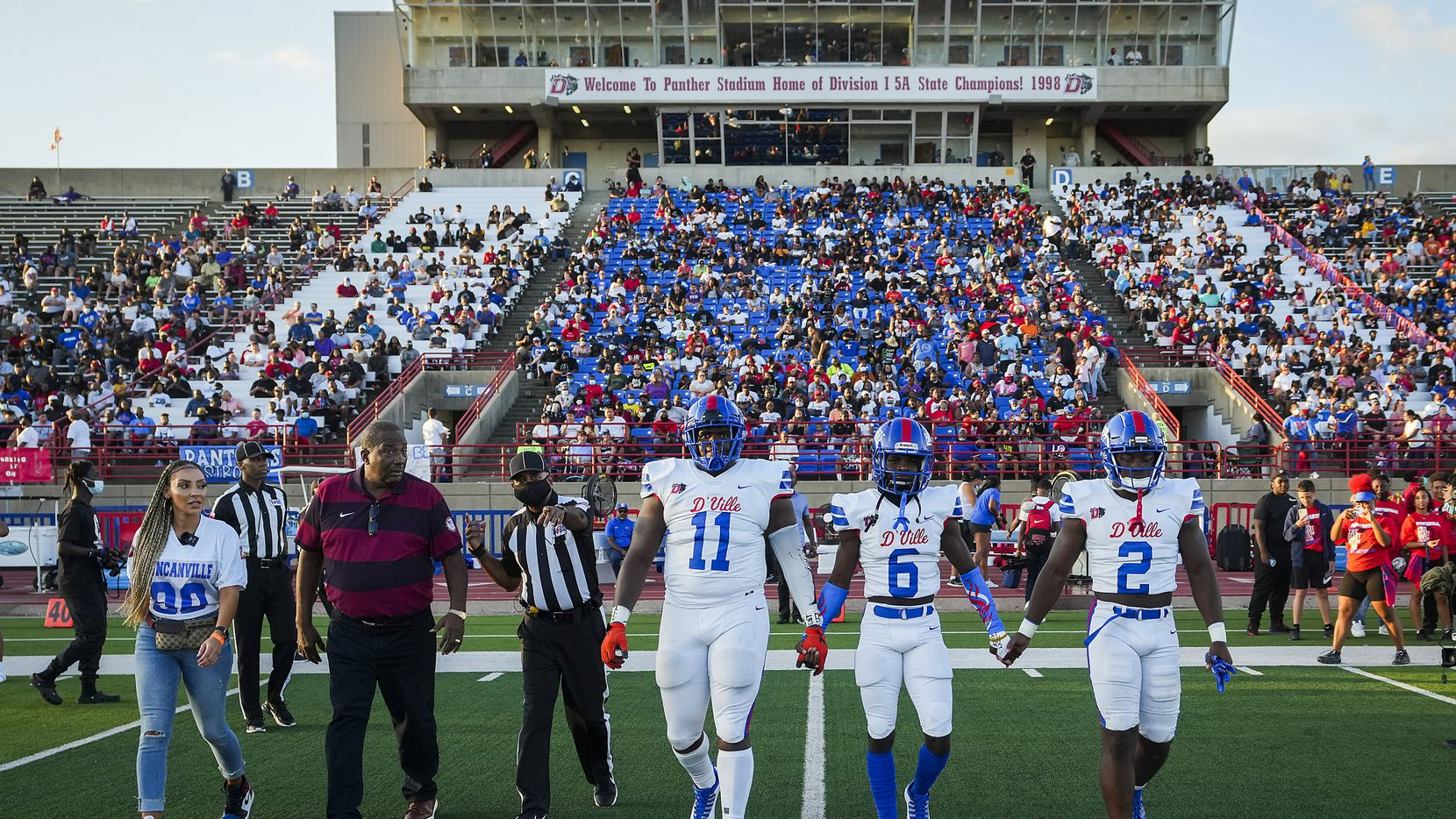 Duncanville's Quincy Wright (11), Da'Myrion Colemann (6) and linebacker Jordan Crook (2) walk out for the opening coin toss with State Senator Royce West before a high school football game against Mater Dei on Friday, Aug. 27, 2021, in Duncanville. (Smiley N. Pool/The Dallas Morning News)