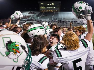 Southlake Carroll players celebrate after a 36-35 victory over Rockwall-Heath in a high school football game at Wilkerson-Sanders Stadium on Thursday, Sept. 2, 2021, in Rockwall. (Smiley N. Pool/The Dallas Morning News)