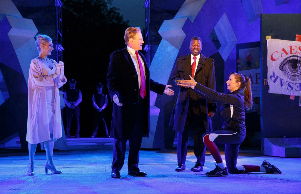 In this May 21, 2017 photo provided by The Public Theater, Tina Benko, left, portrays Melania Trump in the role of Caesar's wife, Calpurnia, and Gregg Henry, center left, portrays President Donald Trump in the role of Julius Caesar during a dress rehearsal of The Public Theater's Free Shakespeare in the Park production of Julius Caesar, in New York. Rounding out the cast on stage is Teagle F. Bougere as Casca, and Elizabeth Marvel, right, as Marc Anthony