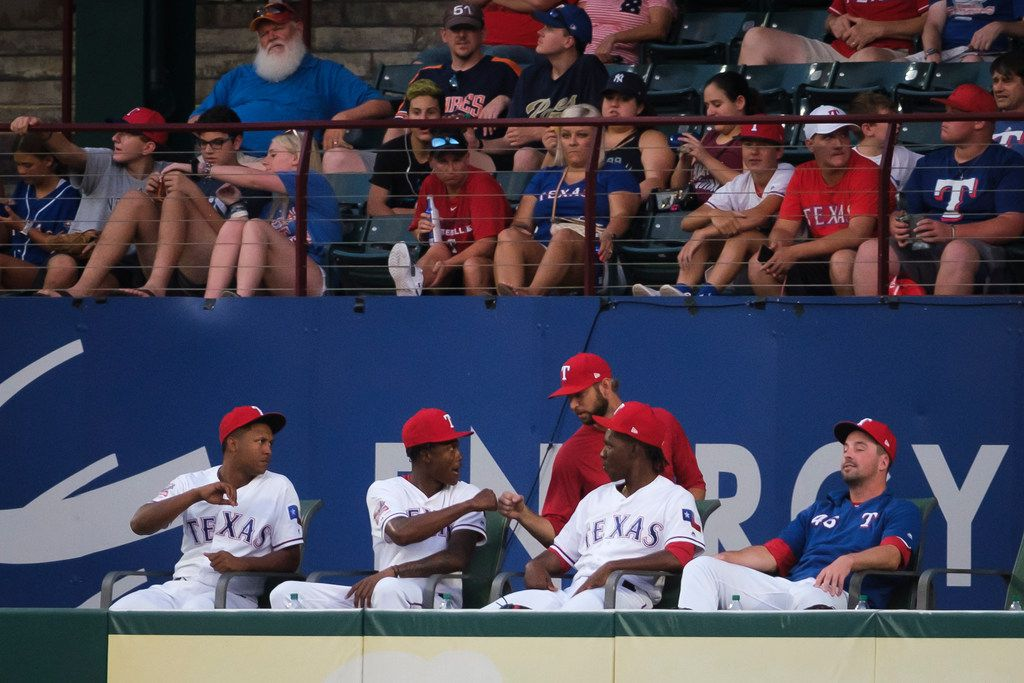 Texas Rangers relief pitcher Chris Martin (standing in red) says goodbye to teammates in the Rangers bullpen after news broke that he had been traded to the Atlanta Braves during the fourth inning against the Seattle Mariners at Globe Life Park on Tuesday, July 30, 2019, in Arlington. (Smiley N. Pool/The Dallas Morning News)