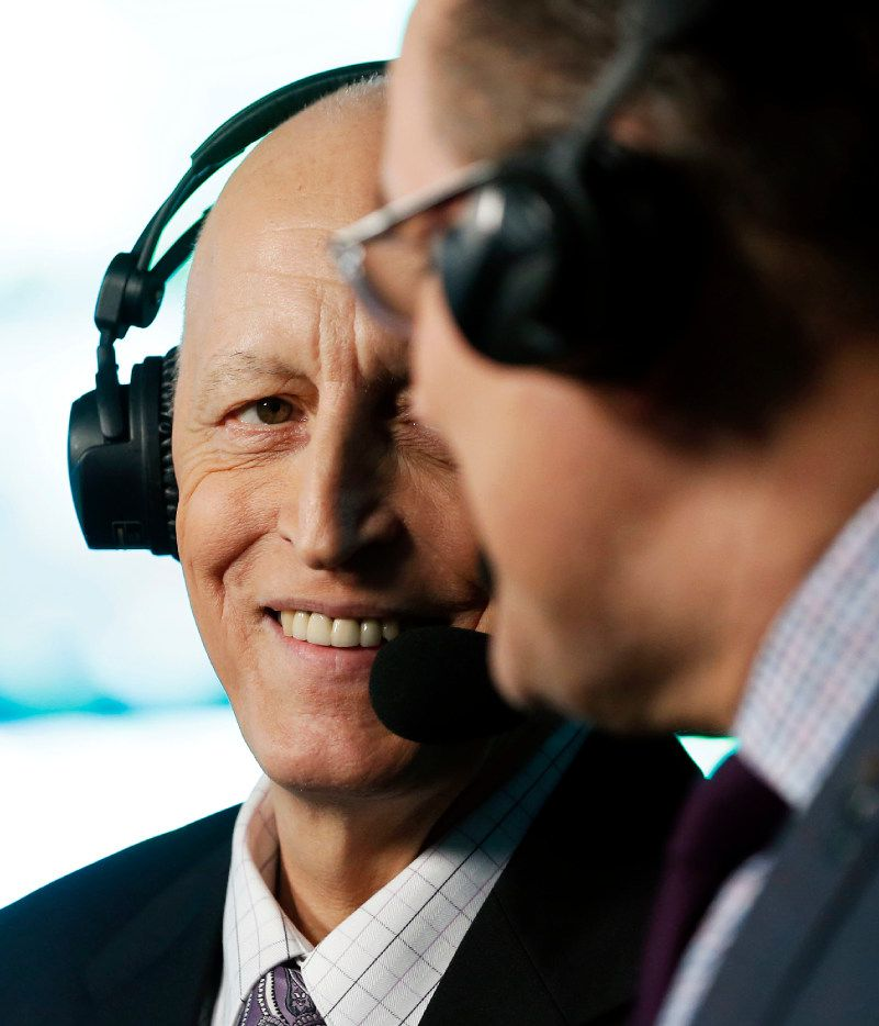 "Dallas Stars play-by-play Dave Strader listens to broadcast partner Daryl ""Razor"" Reaugh before a game between the Dallas Stars and Tampa Bay Lightning at American Airlines Center in Dallas on Saturday, February 18, 2017. Strader has been battling bile duct cancer and this is his first game back since last season. (Vernon Bryant/The Dallas Morning News)"