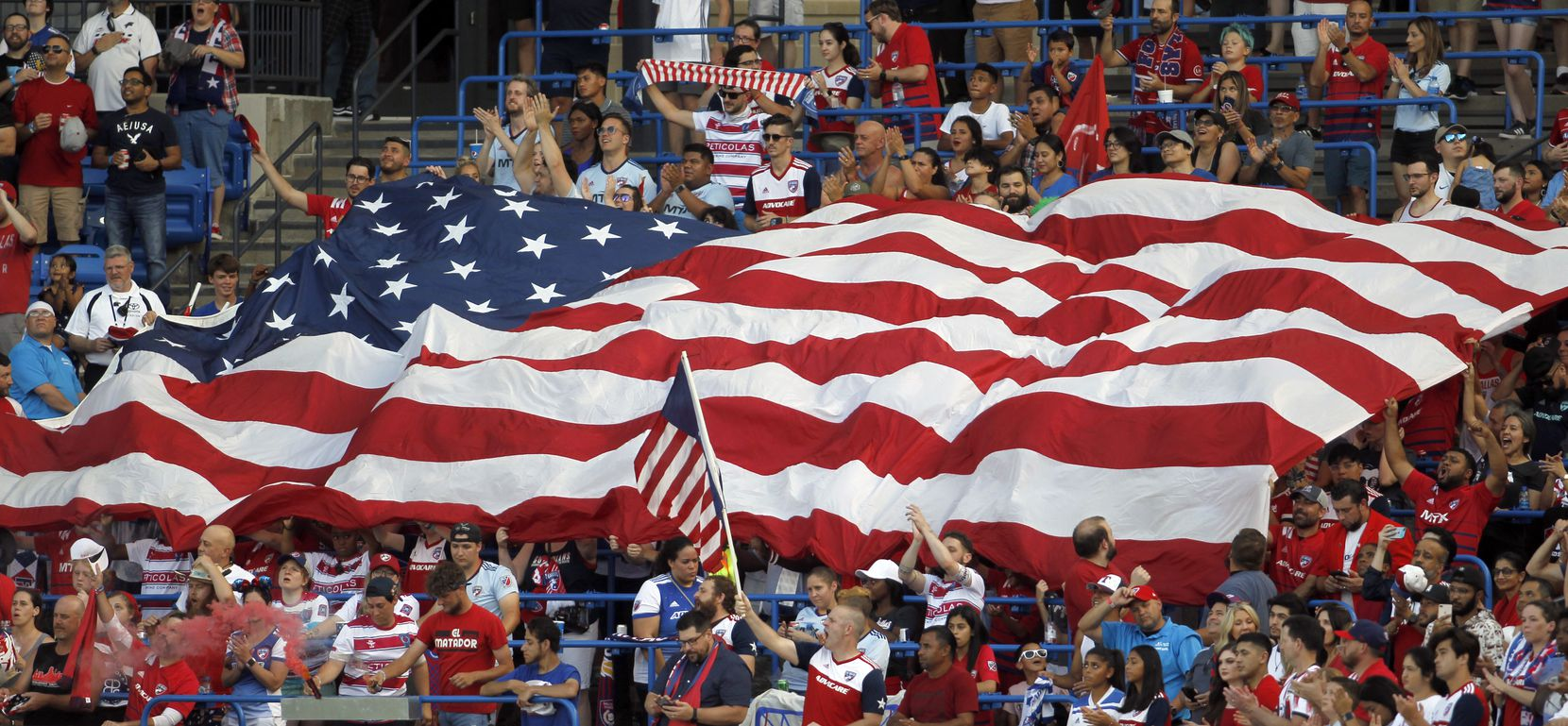 FC Dallas fans frame a Texas-sized American flag in the stands during the playing of the national anthem prior to the In dependance Day match between FC Dallas and the Vancouver Whitecaps. The two Major League Soccer teams played their match at Toyota Stadium in Frisco on July 4, 2021. (Steve Hamm/ Special Contributor)