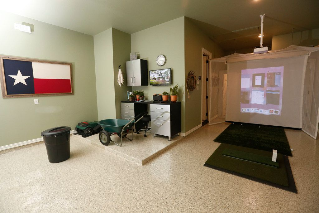 In the HGTV Smart Home garage, its new owner can use a golf simulator. There's also a storm shelter in a back corner. The garage has room for three cars.