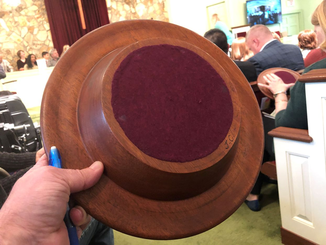 """Jimmy Carter has touched Maranatha Baptist in many ways. He even made the offering plates. His initials """"J.C."""" appear at right."""