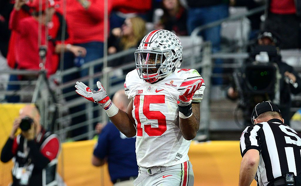 Running back Ezekiel Elliott #15 of the Ohio State Buckeyes celebrates his fourth touchdown of the game during the third quarter of the BattleFrog Fiesta Bowl against the Notre Dame Fighting Irish at University of Phoenix Stadium on January 1, 2016 in Glendale, Arizona.  (Photo by Jennifer Stewart/Getty Images)