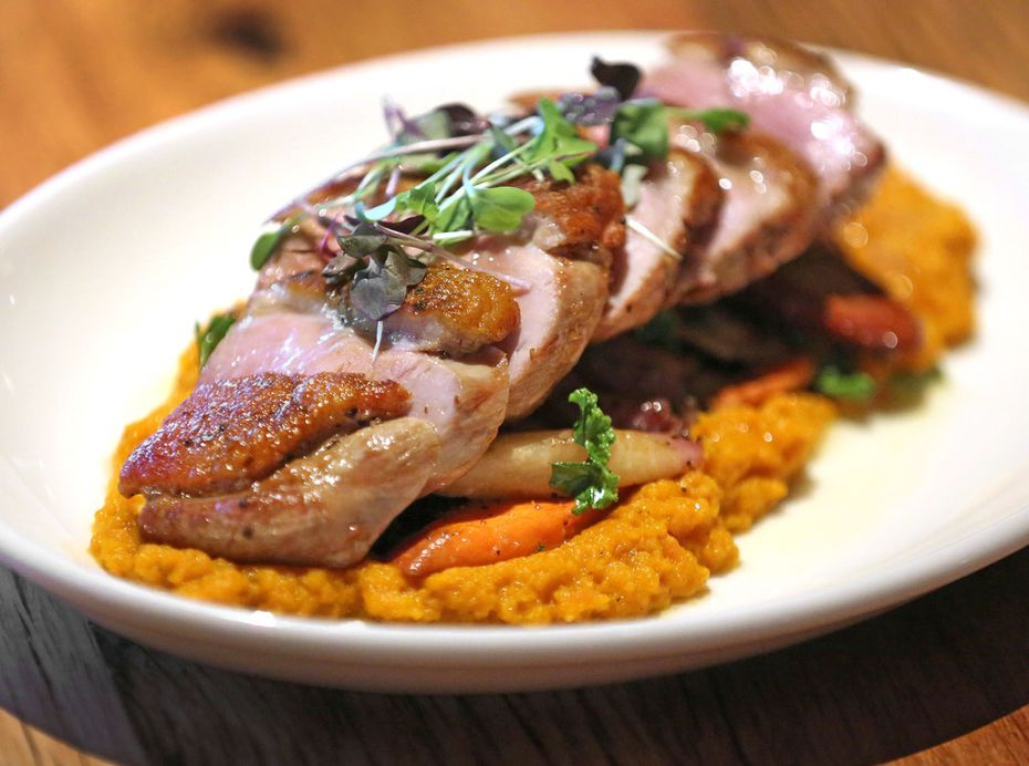 Grilled duck breast is one of the menu items at the new Whiskey Cake in the Las Colinas/Irving area.
