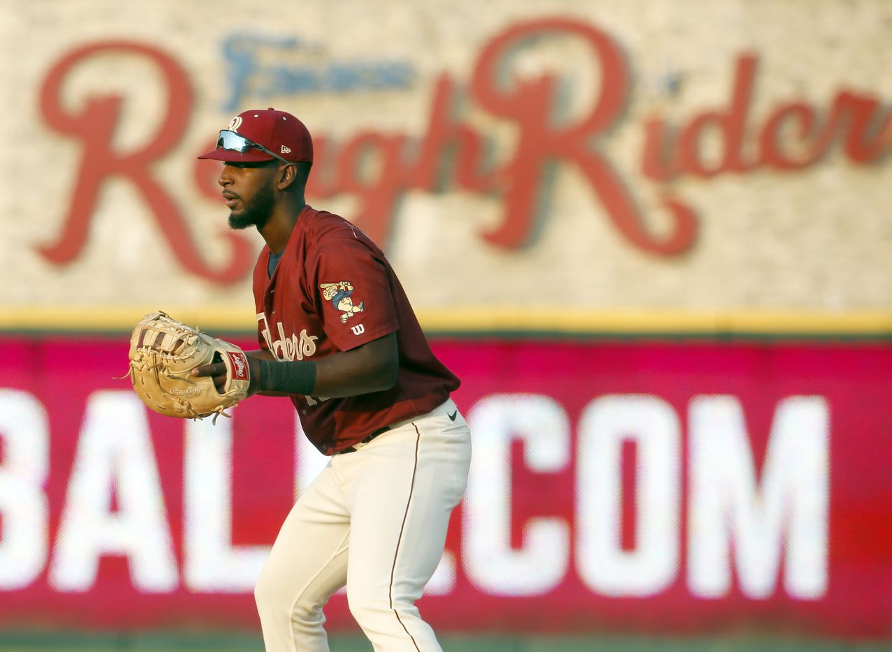 Frisco RoughRiders first baseman Sherten Apostel (12) works to keep a San Antonio baserunner close during the top of the 2nd inning of play. The two teams played their minor league baseball game at Riders Field in Frisco on June 22, 2021 (Steve Hamm/ Special Contributor)