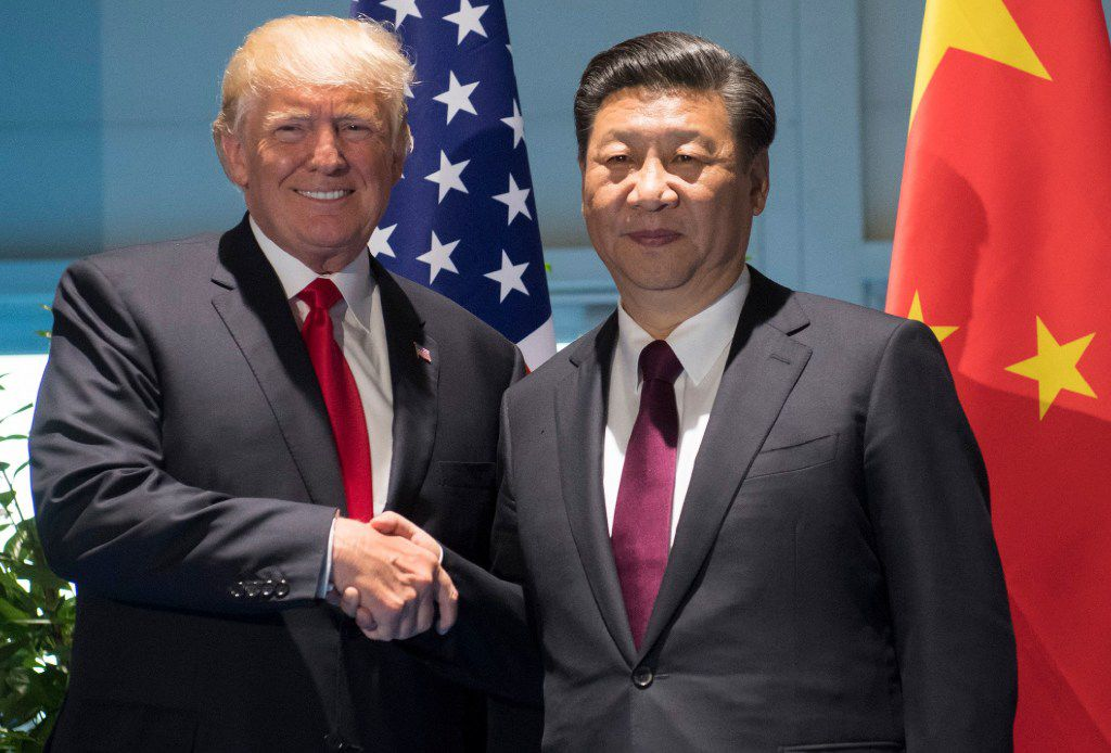 U.S. President Donald Trump and Chinese President Xi Jinping shake hands prior to a meeting on the sidelines of the G20 Summit in Hamburg, Germany, on July 8, 2017.