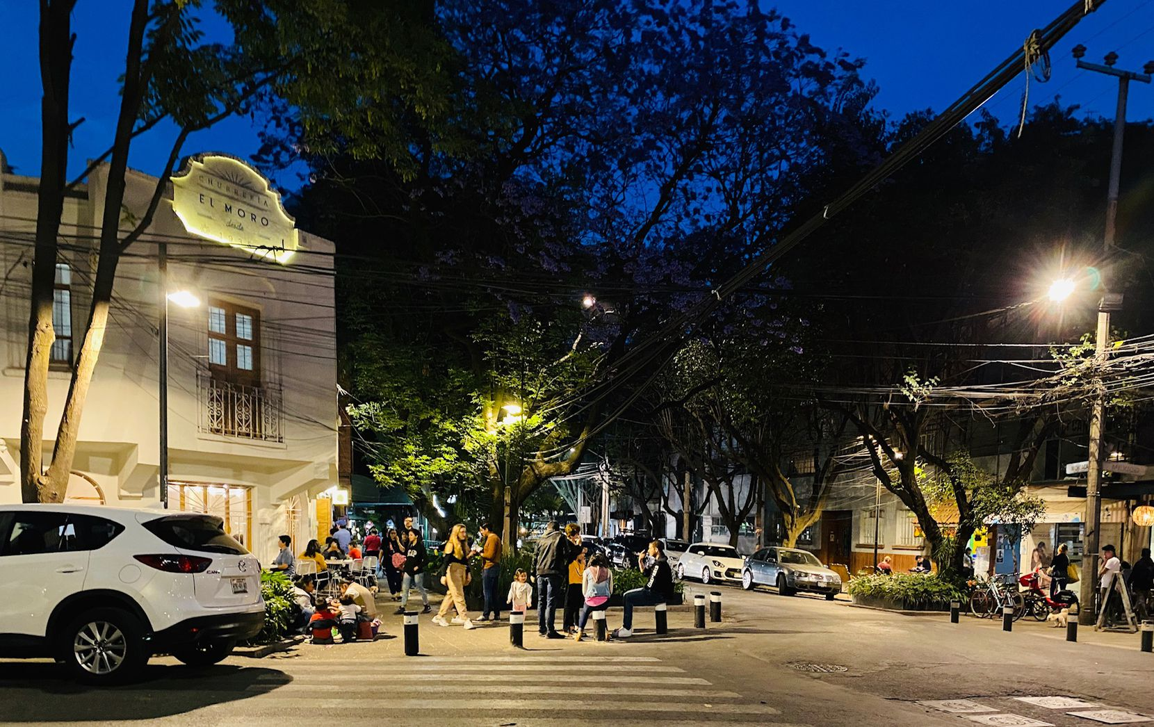 Mexico City's Parque Mexico, seen here earlier this week, is a favorite hang out for tourists, a leafy neighborhood with dozens of outdoor coffee places and eateries, including El Moro, which specializes in churros, something akin to sweet, fried tacos.