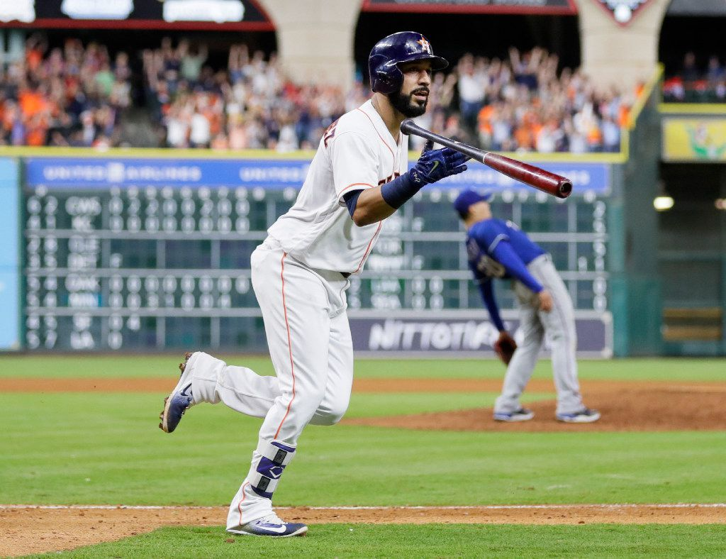Houston Astros' Marwin Gonzalez tosses his bat after hitting a grand slam off Texas Rangers relief pitcher Keone Kela, right, during the eighth inning of a baseball game, Tuesday, May 2, 2017, in Houston. (AP Photo/David J. Phillip)