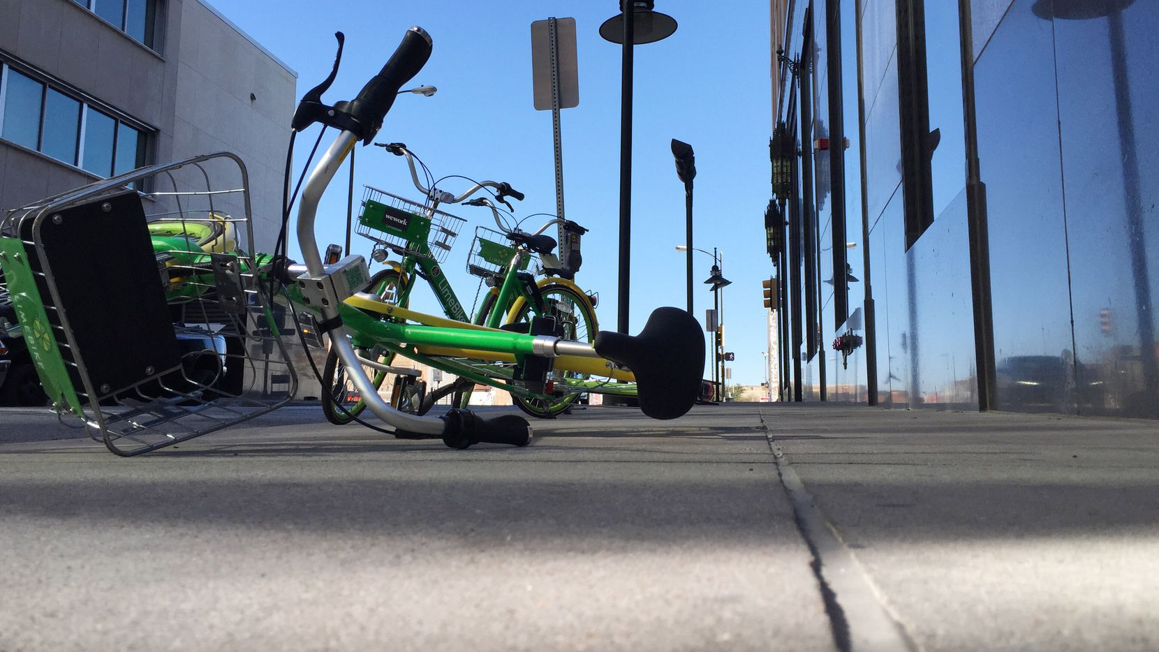 STOCK - A LimeBike lies on a sidewalk on Harwood St in downtown Dallas, Texas on December 27, 2017. (Irwin Thompson/Staff Photographer) Bike Share