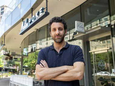 Jon Alexis, owner of TJ's Fresh Seafood and Malibu Poke, poses for a portrait outside one of his uptown restaurants on Tuesday, April 21, 2020 in Dallas.