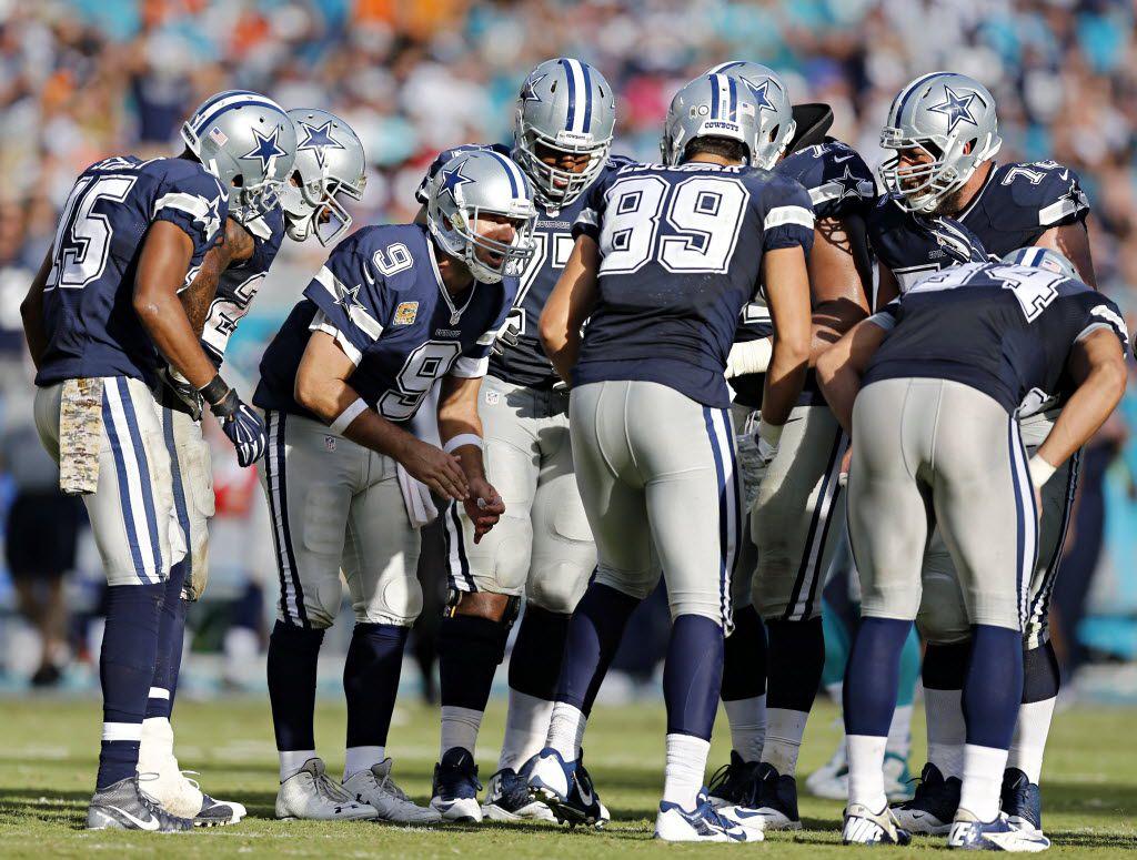 Dallas Cowboys quarterback Tony Romo (9) breaks the huddle during the second half Dallas' 24-14 win over the Miami Dolphins at Sun Life Stadium Sunday, November 22, 2015 in Miami Gardens, Fla. (G.J. McCarthy/The Dallas Morning News)