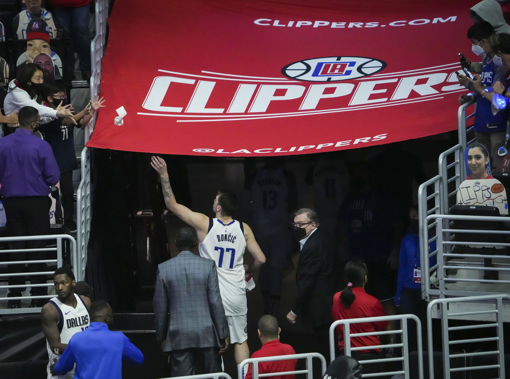 Dallas Mavericks guard Luka Doncic tosses a sweatband to the crowd as he leaves the court after a loss to the LA Clippers in Game 7 of an NBA playoff series at the Staples Center on Sunday, June 6, 2021, in Los Angeles.