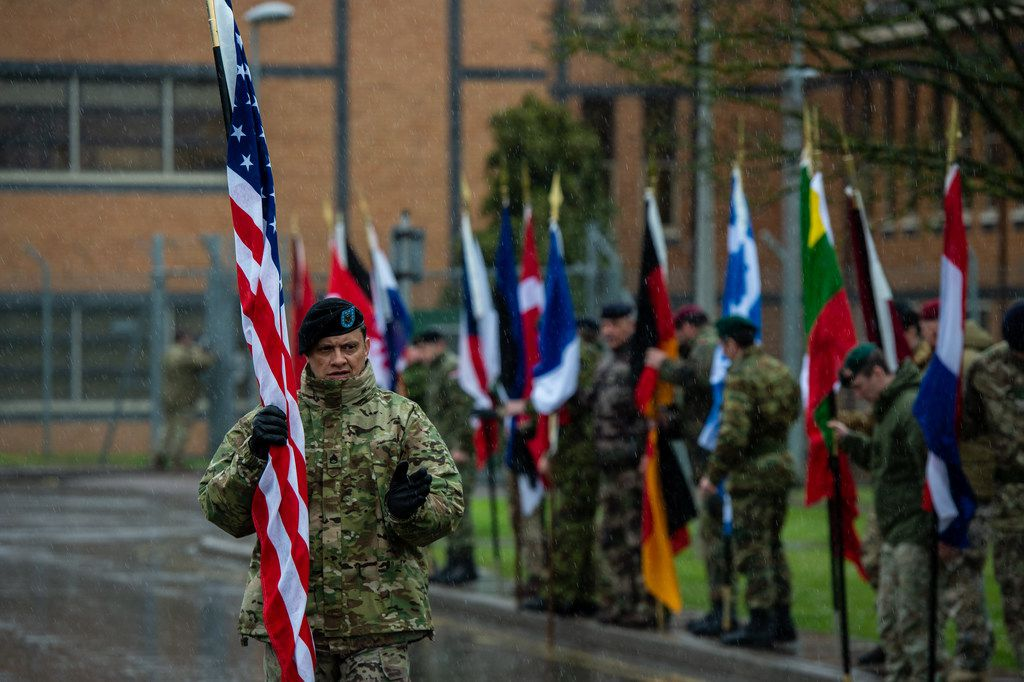 A member of American NATO military personnel walks to his position at the start of the NATO commemorative parade at Imjin Barracks on April 4, 2019, in Gloucester, England. This week NATO turns 70 years old.