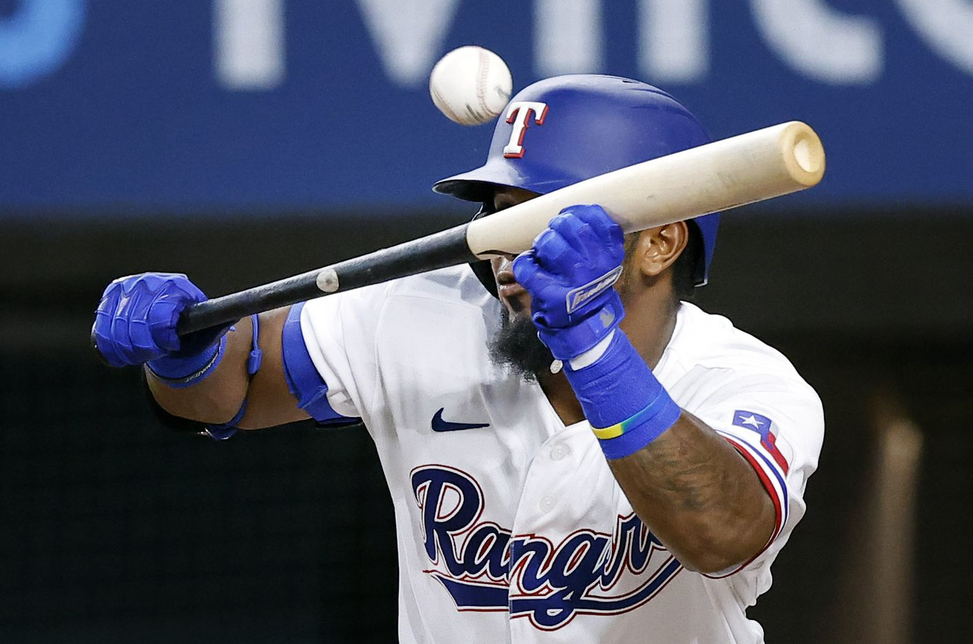 Texas Rangers batter Yonny Hernandez (65) bunts out to third base during his third inning at-bat against the Oakland Athletics at Globe Life Field in Arlington, Saturday, August 14, 2021.(Tom Fox/The Dallas Morning News)