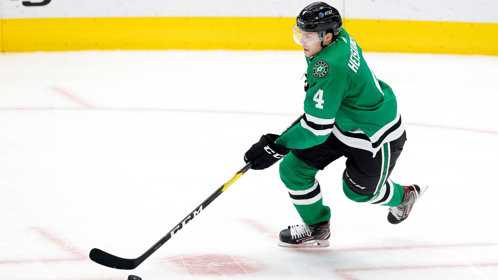 FILE — Dallas Stars defenseman Miro Heiskanen (4) brings the puck up ice against the Columbus Blue Jackets during the third period at the American Airlines Center in Dallas, Thursday, March 4, 2021. The Stars fell to the Blue Jackets, 3-2.