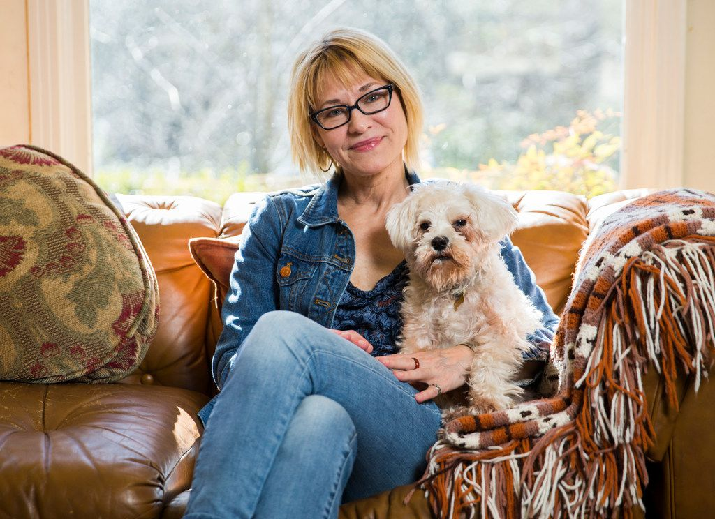 Author Elizabeth Crook poses for a portrait with her dog, Francis, in her living room on Monday, January 22, 2018 in Austin.