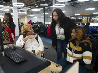 "LaTrisha Beaudion, left goes over call-backs with LaTricia  Jones and LeRoya Moore at Chime Solutions'  RedBird offices.  ""The entire country is missing out on these talent pools,"" says Chime owner Mark Wilson."