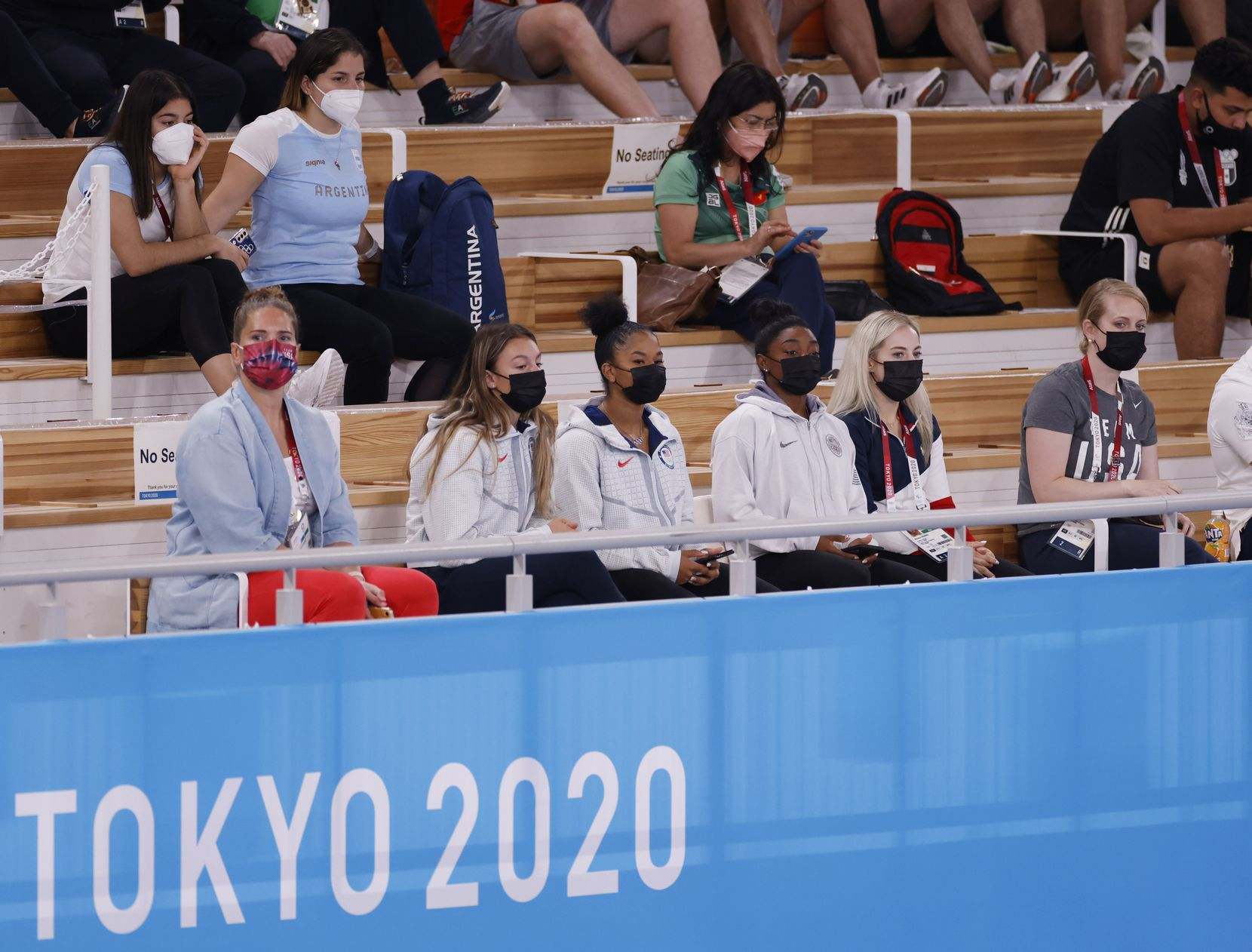 (From l to r) USA's Grace McCallum, Jordan Chiles, Simone Biles, and MyKayla Skinner watch competition during the women's gymnastics individual all-around final at the postponed 2020 Tokyo Olympics at Ariake Gymnastics Centre, on Thursday, July 29, 2021, in Tokyo, Japan. (Vernon Bryant/The Dallas Morning News)