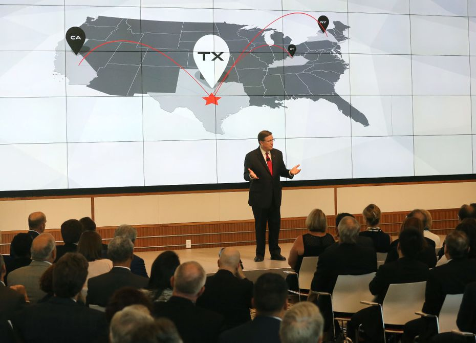 Toyota North America CEO Jim Lentz talks with the crowd at the grand opening of the new headquarters in Plano.