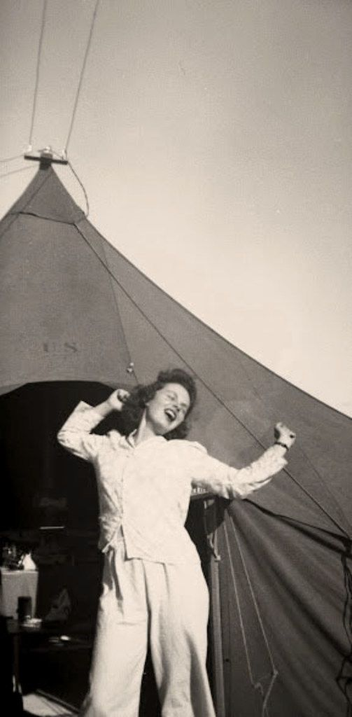 Sarah Bird's mother, then  Lt. Colista Marie McCabe, R.N., outside her tent in Tunisia in advance of the Invasion of Sicily in World War II.