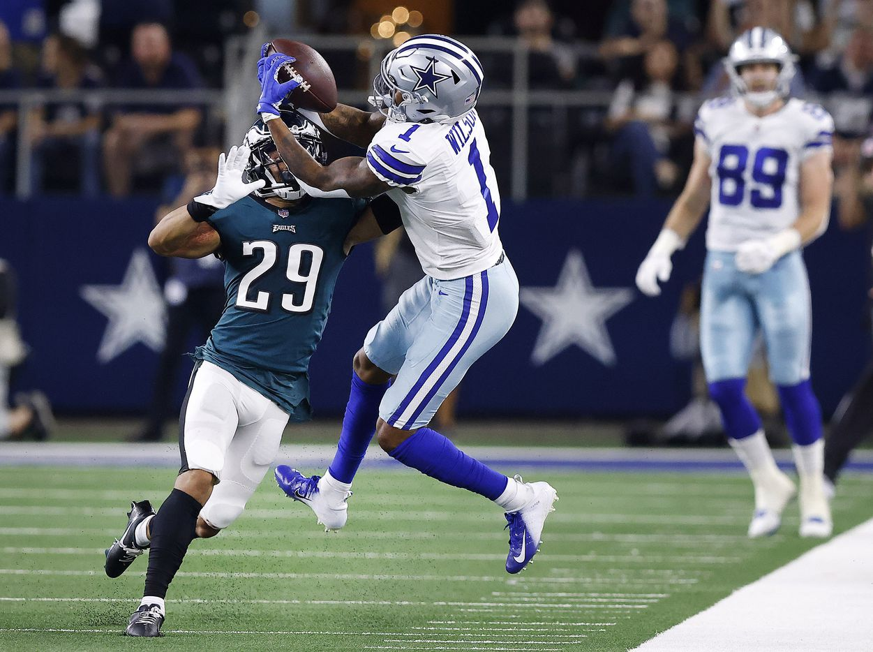 Dallas Cowboys wide receiver Ced Wilson (1) catches a pass over Philadelphia Eagles free safety Avonte Maddox (29) but was unable to get both feet down in bounds during the second quarter at AT&T Stadium in Arlington, Monday, September 27, 2021. (Tom Fox/The Dallas Morning News)