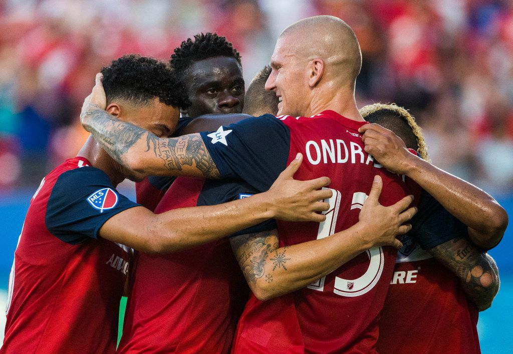 FC Dallas players celebrate after FC Dallas defender Reto Ziegler (3) kicked a goal on a penalty shot during the first half of an MLS game between FC Dallas and Houston Dynamo on Sunday, August 25, 2019 at Toyota Stadium in Frisco, Texas. (Ashley Landis/The Dallas Morning News)