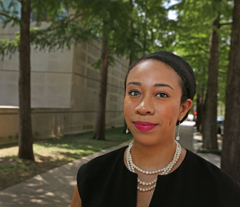 Lawyer-activist Dominique Torres poses in downtown Dallas and says she remains committed to police reform issues. (Louis DeLuca/The Dallas Morning News)