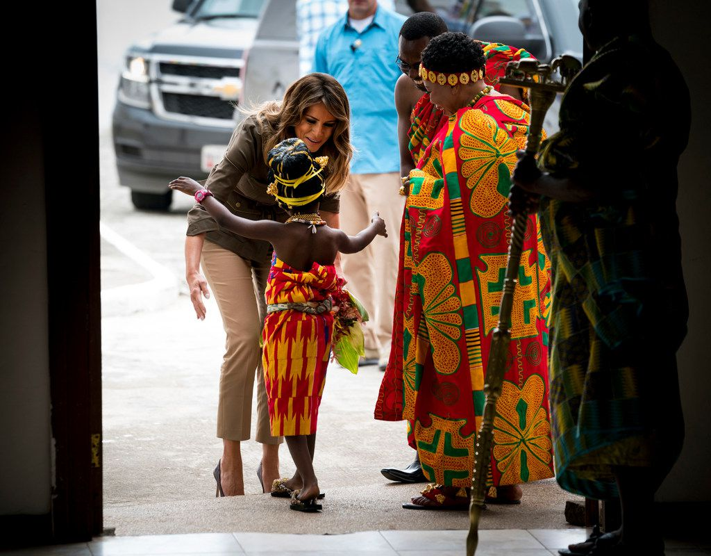 First lady Melania Trump is greeted by a young girl as she arrives to visit the Emintsimavze Palace in Cape Coast, Ghana, on Wednesday, Oct. 3, 2018.  In her first big solo trip abroad, the first lady is scheduled to visit four African countries in the span of a week: Ghana, Kenya, Malawi and Egypt.