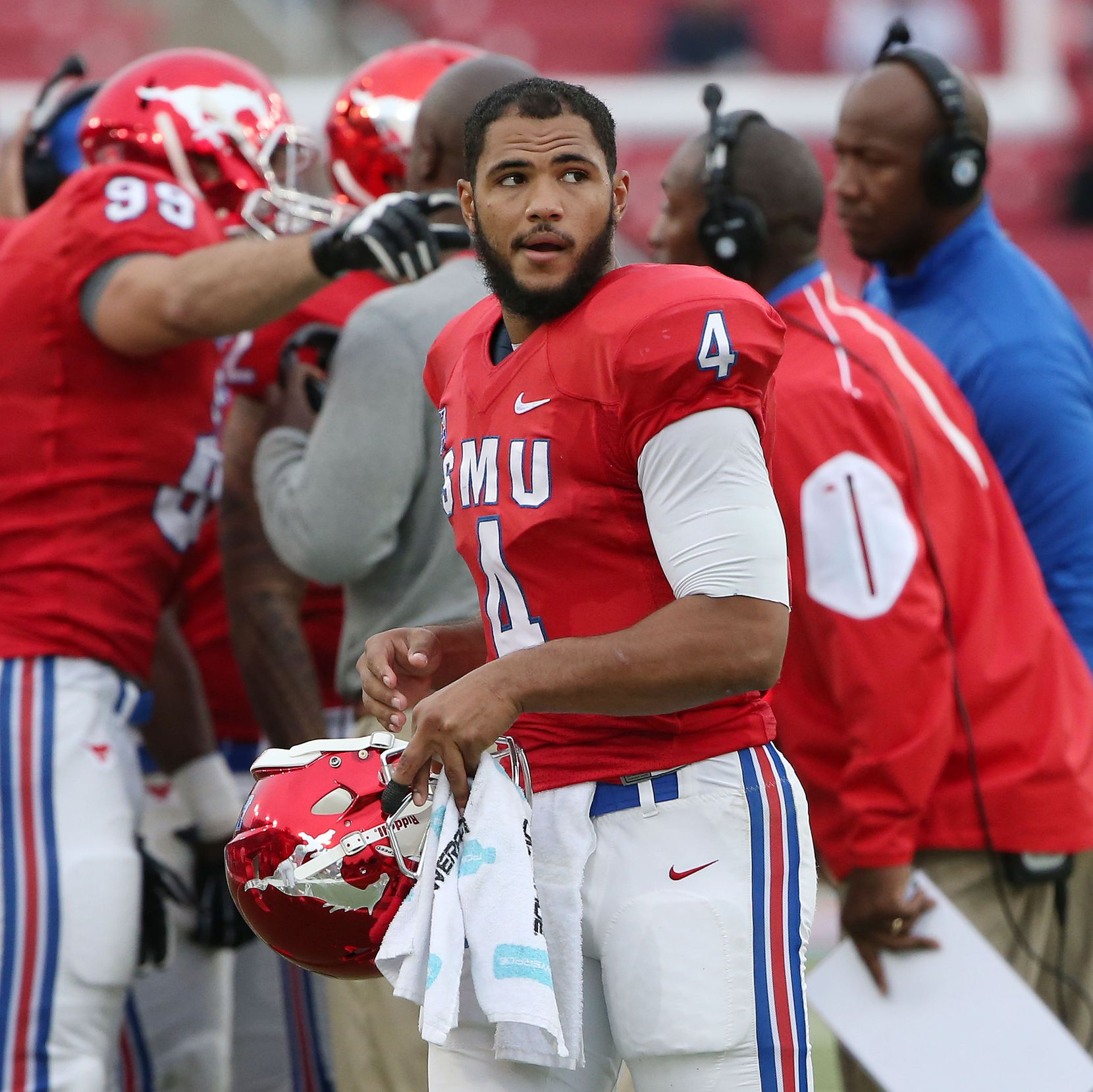 Southern Methodist Mustangs quarterback Matt Davis (4) walks by the huddle in the first quarter during an NCAA football game between Tulsa and SMU at Gerald J. Ford Stadium in Dallas Saturday October 31, 2015. Tulsa Golden Hurricane beat Southern Methodist Mustangs 40-31. (Andy Jacobsohn/The Dallas Morning News)