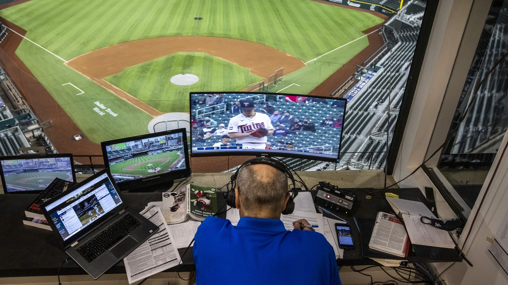 Texas Rangers broadcaster Eric Nadel announces the game between the Texas Rangers game and the Minneapolis Twins from an empty Globe Life Field in Arlington, Texas on Monday, May 3, 2021.