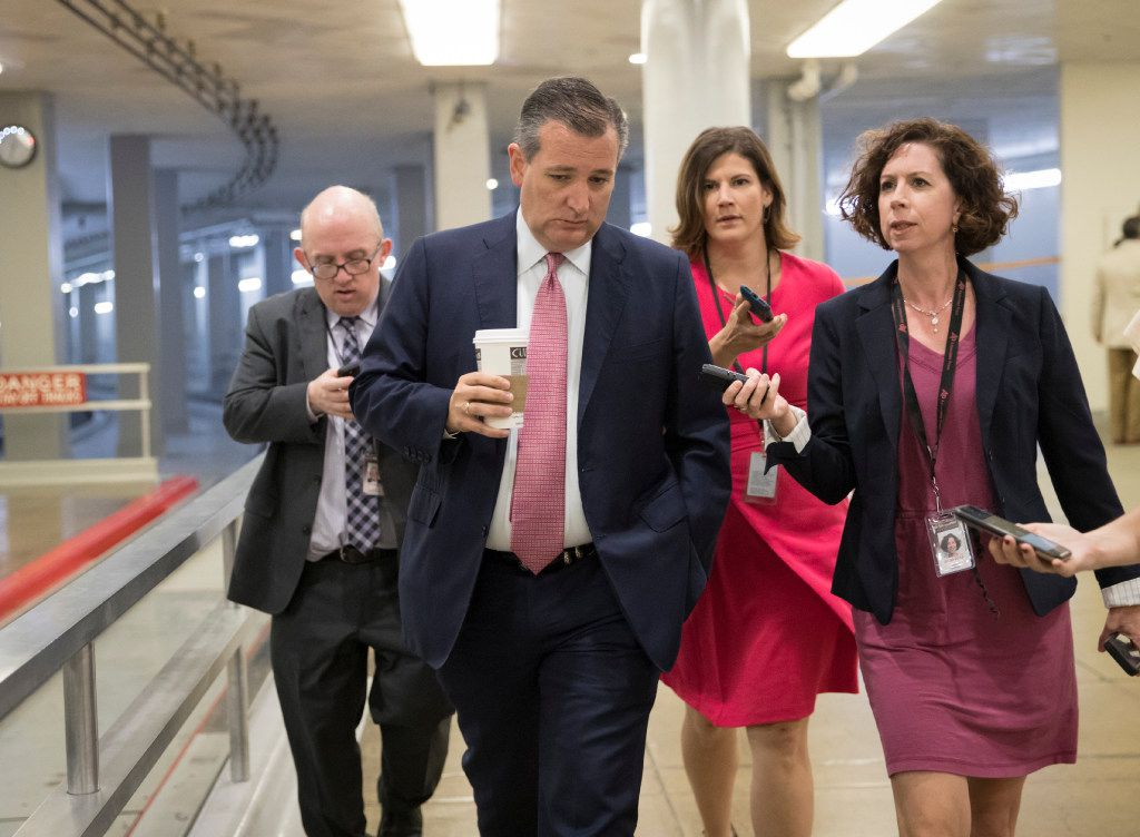 Sen. Ted Cruz, R-Texas, heads to the Senate chamber for a vote in Washington on Thursday, July 20, 2017. Majority Leader Mitch McConnell is spurring Republican senators to resolve internal disputes that have pushed their marquee health care bill to the brink of oblivion, a situation made more difficult for the GOP because of Sen. John McCain's diagnosis of brain cancer.